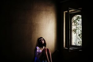 girl alone in a room