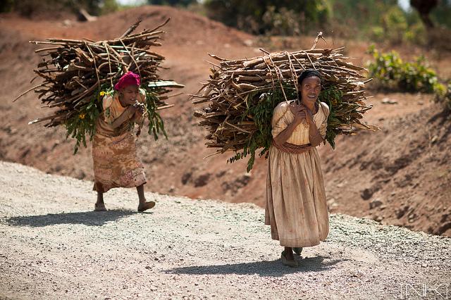 women carrying heavy loads